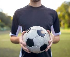 man holding soccer ball- sound fc