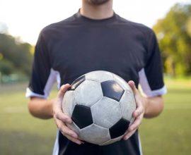 man holding soccer ball- sound fc
